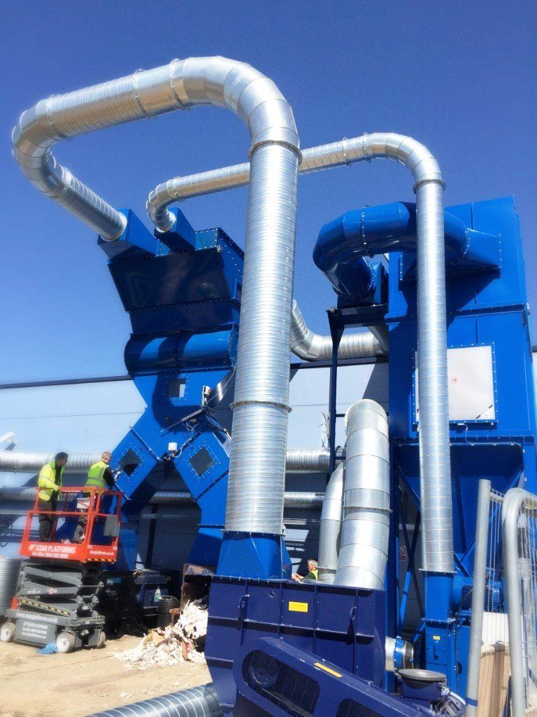 <h2>Diverter, Chutes and Ductwork </h2><p>All of the blue items in these pictures were made by us and are looking good in the sunshine! The diverter, chutes and ductwork that we manufactured help to make up this cardboard recycling system!</p>